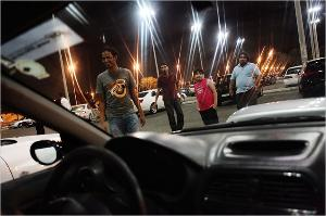 Saudi Arabia's Young Men Gather Late At Night to Race Cars … and Cruise?