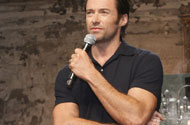 Hugh Jackman Zips Into the Gun Show