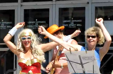 Rep. Tammy Baldwin Throws Her Hands Up For Wisconsin's Superhero Pride