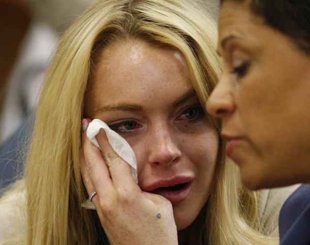 Lindsay Lohan (L) cries next to her lawy
